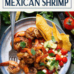 Overhead shot of Mexican shrimp on a plate with text title box at top