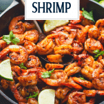 Close up side shot of Mexican shrimp in a skillet with text title overlay