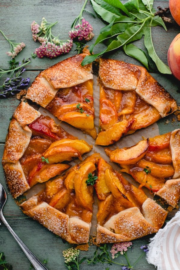 Overhead image of a sliced easy peach galette with Pillsbury pie crust and fresh summer peaches