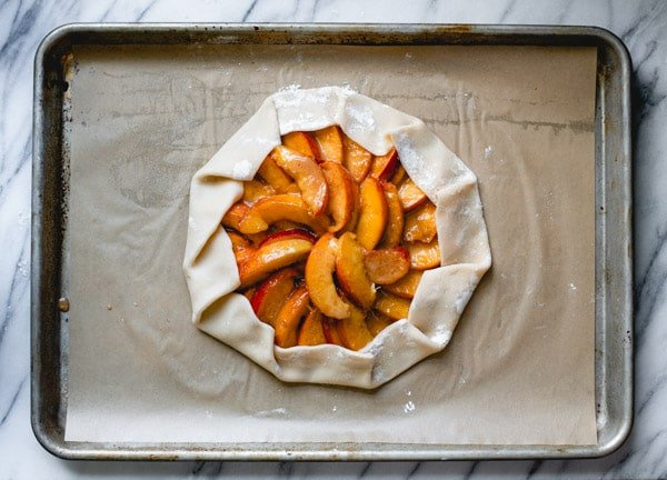 Process shot showing how to make peach galette