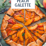 Overhead shot of peach galette recipe on a wooden board with text title overlay