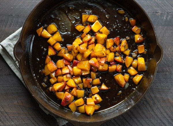 Peach sauce in a cast iron skillet