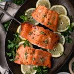 Overhead shot of oven roasted in salmon in an iron pan