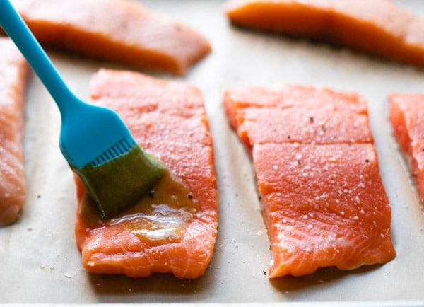 Brushing salmon fillets with brown sugar glaze