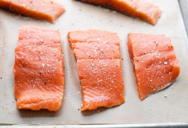 Salmon fillets on a baking sheet