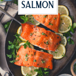 Overhead shot of oven roasted salmon with text title overlay