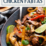 Side shot of a pan of the best chicken fajita recipe with text title box at top