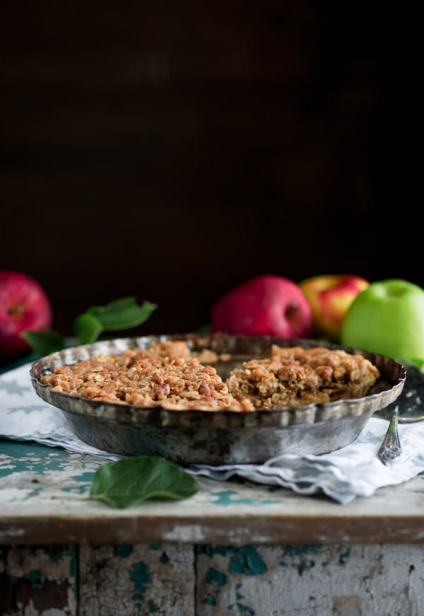 Side shot of the best Dutch apple pie recipe on a blue chest