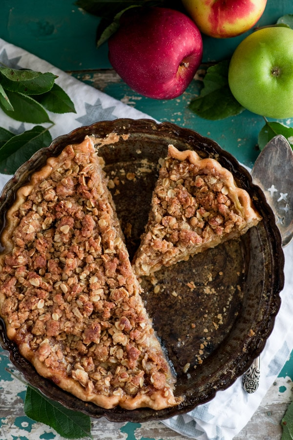 Overhead shot of a sliced traditional Dutch apple pie with oats