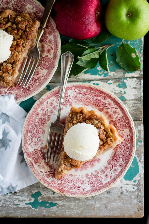 Overhead shot of two small red and white vintage plates with slices of dutch apple pie