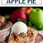 Dutch crumb apple pie on a plate with ice cream and text title box at top