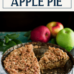 Sliced apple crumble pie with text title box at top