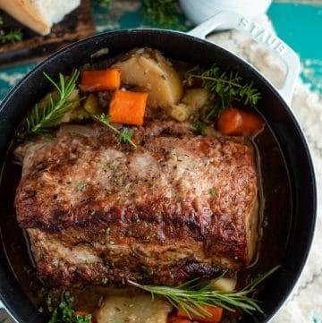 Close overhead shot of a boneless pork loin in a Dutch oven