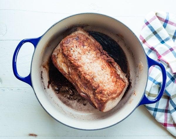 Seared pork loin roast in a Dutch oven