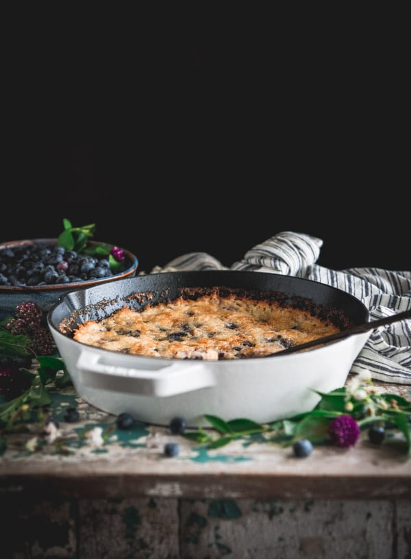 Side shot of an easy blueberry cobbler on a rustic farmhouse table