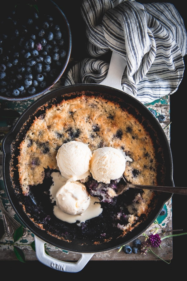 Overhead shot of an easy blueberry cobbler in a cast iron skillet