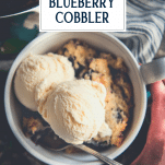Overhead shot of the best blueberry cobbler with text title overlay