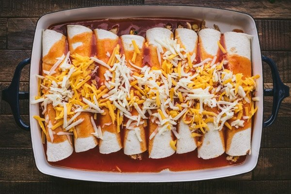 Process shot showing how to make easy chicken enchiladas