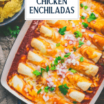 Overhead shot of easy chicken enchiladas on a wooden table with text title overlay