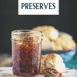 Spoon in a jar of whole fig preserves recipe with text title overlay