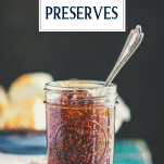 Spoon in a jar of old fashioned fig preserves with text title overlay