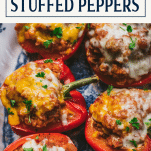 Close overhead image of stuffed bell pepper recipe with ground turkey and text title box at top