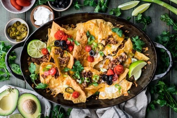 Horizontal shot of loaded nachos supreme
