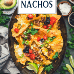 Overhead shot of homemade nachos with ground beef and text title overlay