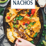 Overhead image of a tray of homemade nachos with text title overlay