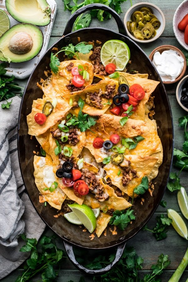 Overhead shot of the best homemade nachos recipe with toppings