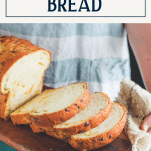 Jalapeno cheddar bread on a wooden board with text title box at top