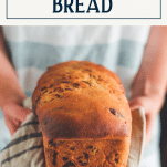 Jalapeno and cheddar bread in a towel with text title box at top