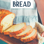 Sliced loaf of jalapeno cheddar cheese bread with text title overlay