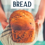Hands holding a loaf of jalapeno cheddar bread with text title overlay
