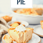 Front shot of a slice of easy peanut butter pie with a bite taken out and text title overlay