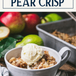 Bowl of warm apple pear crisp with vanilla ice cream and text title box at top