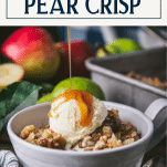Drizzling caramel sauce on a bowl of pear crisp with text title box at top