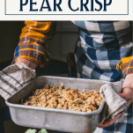Hands holding a pan of baked pear crisp with text title box at top