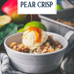 Pouring caramel sauce on a bowl of apple and pear crisp with vanilla ice cream and text title overlay