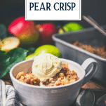 Pear crisp with vanilla ice cream on a table with text title overlay