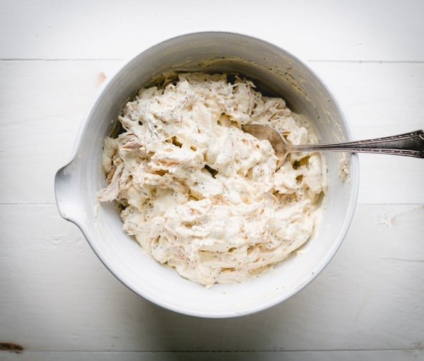 Sour cream and condensed cream of chicken soups in a bowl