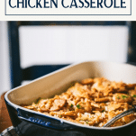 Side shot of the very best poppy seed chicken casserole recipe on a table with text title box at top