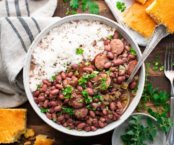 Horizontal shot of homemade red beans and rice served with cornbread