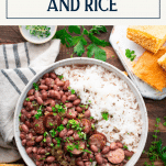 Overhead image of a bowl of red beans and rice with sausage and text title box at top