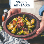 Hands holding a bowl of oven roasted brussels sprouts with balsamic and bacon and text title overlay