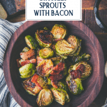 Bowl of oven roasted brussels sprouts with bacon and text title overlay