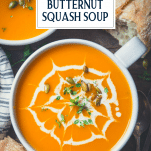 Overhead shot of a bowl of the best butternut squash soup recipe with text title overlay