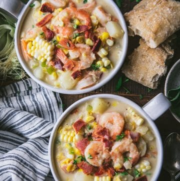Overhead shot of two bowls of shrimp and corn soup