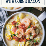 Close overhead image of a bowl of creamy shrimp soup with text title box at top