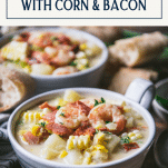 Close up side shot of shrimp and corn soup with text title box at top